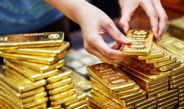 Giá vàng ngày 21/11: Đồng USD lên giá cắt đà tăng của vàng - Ảnh 1.