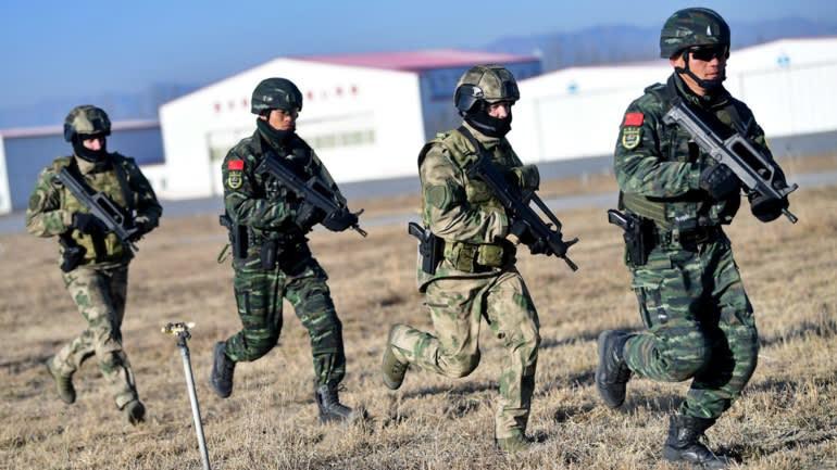 Nga Trung tap tran nguon Reuters