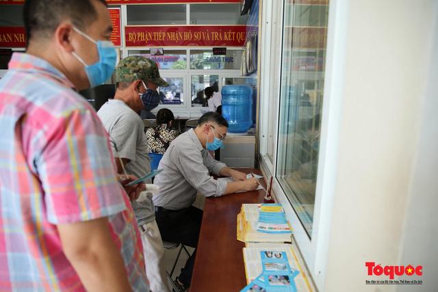 Vai trò của Bộ LĐ-TB&XH đặc biệt quan trọng trong hướng dẫn thực hiện chính sách hỗ trợ người dân gặp khó khăn do Covid-19 - Ảnh 2.