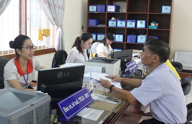 Phó Thủ tướng Vương Đình Huệ trả lời đại biểu Quốc hội về vấn đề bảo hiểm xã hội tự nguyện - Ảnh 1.