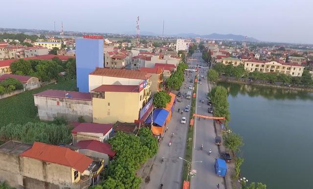 Bắc Giang có huyện đầu tiên đạt chuẩn nông thôn mới - Ảnh 1.