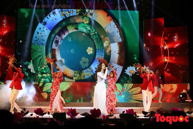 Hồ Ngọc Hà diện áo dài trắng tinh khôi hát Vang mãi giai điệu Tổ Quốc 2019 - Ảnh 5.