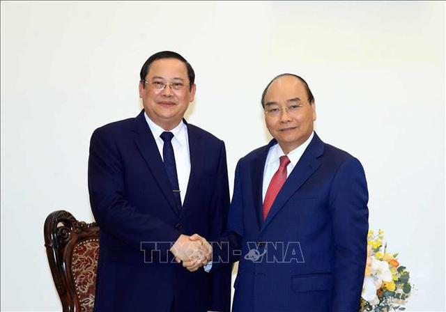 Thủ tướng Chính phủ tiếp Phó Thủ tướng, Bộ trưởng Lào - Ảnh 1.