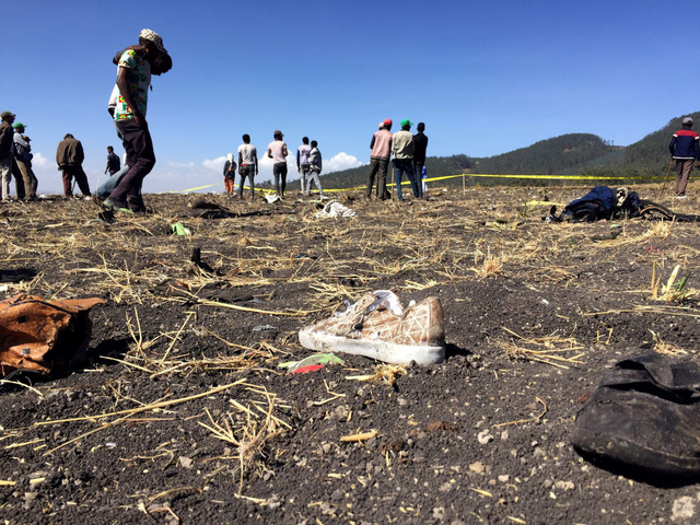 Những khoảnh khắc ám ảnh tại hiện trường vụ tại nạn máy bay Ethiopia - Ảnh 9.