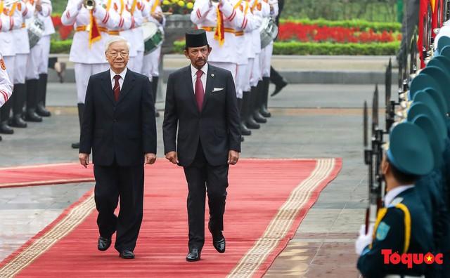 Tổng Bí thư, Chủ tịch nước Nguyễn Phú Trọng chủ trì Lễ đón chính thức Quốc vương Brunei thăm cấp Nhà nước tới Việt Nam - Ảnh 9.