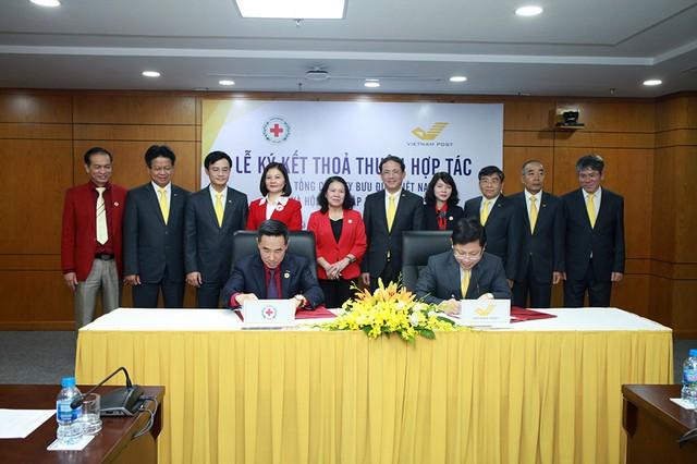 Tổng công ty Bưu điện Việt Nam và Trung ương Hội Chữ Thập đỏ Việt Nam ký thỏa thuận hợp tác - Ảnh 3.