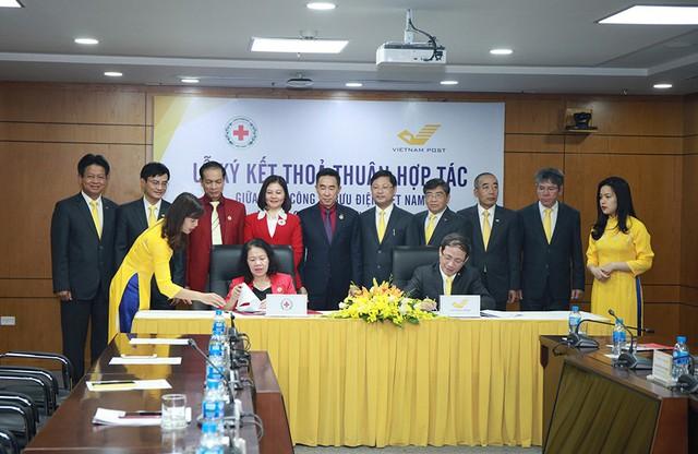 Tổng công ty Bưu điện Việt Nam và Trung ương Hội Chữ Thập đỏ Việt Nam ký thỏa thuận hợp tác - Ảnh 2.