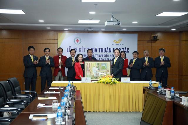 Tổng công ty Bưu điện Việt Nam và Trung ương Hội Chữ Thập đỏ Việt Nam ký thỏa thuận hợp tác - Ảnh 4.