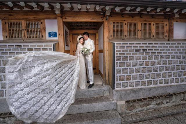 Ốc Thanh Vân khoe ảnh cưới chụp tại Hàn Quốc, vô tình để lộ hình xăm gợi cảm - Ảnh 6.