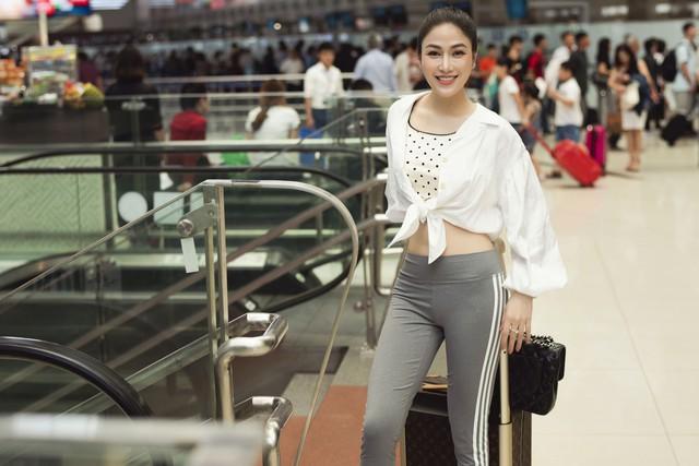 Hoa hậu Tuyết Nga tham dự LHP Cannes bằng 50kg trang phục  - Ảnh 1.