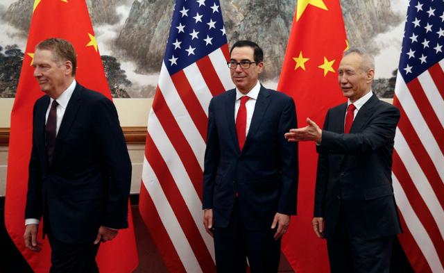 Đàm phán thương mại Mỹ-Trung có thể về đích giữa tháng 5? - Ảnh 1.