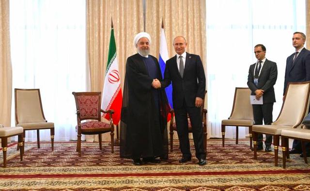 Khẳng định của TT Putin về bắt tay Nga-Iran và tương lai Syria - Ảnh 1.