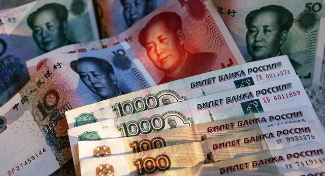 Tiền tệ Nga – Trung hợp lực đánh bật đồng bạc xanh - Ảnh 1.