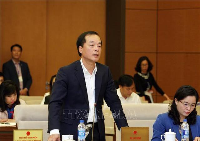 Bị truy trách nhiệm về xử lý sai phạm nhà 8B Lê Trực, HH Linh Đàm, Bộ trưởng Xây dựng nói đây là trách nhiệm của TP Hà Nội - Ảnh 1.
