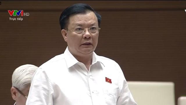 Bộ trưởng Đinh Tiến Dũng báo cáo trước Quốc hội về vấn đề thất thu thuế đối với Uber, Grab - Ảnh 1.