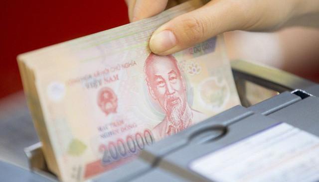 Bộ Ngoại giao khẳng định Việt Nam không có ý định thao túng tiền tệ - Ảnh 1.