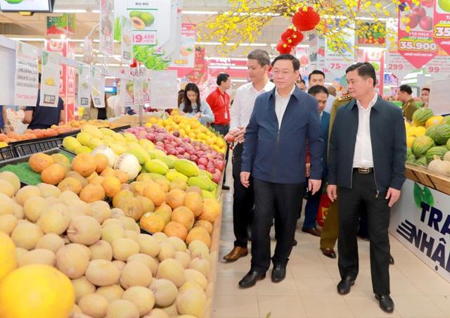 Hình ảnh Phó Thủ tướng Vương Đình Huệ đi chợ Tết - Ảnh 7.