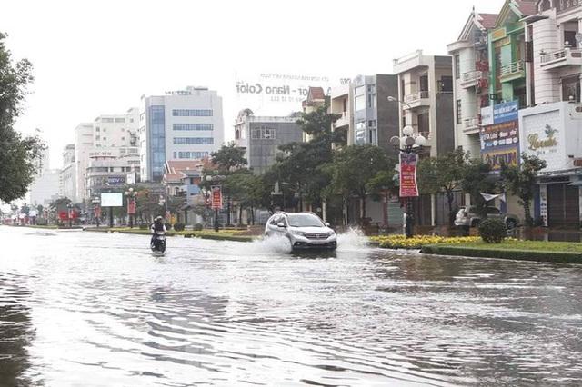 Nam Định ngập sâu, người dân 'thúc thủ' trong nhà ngày mùng 1 Tết - Ảnh 4.