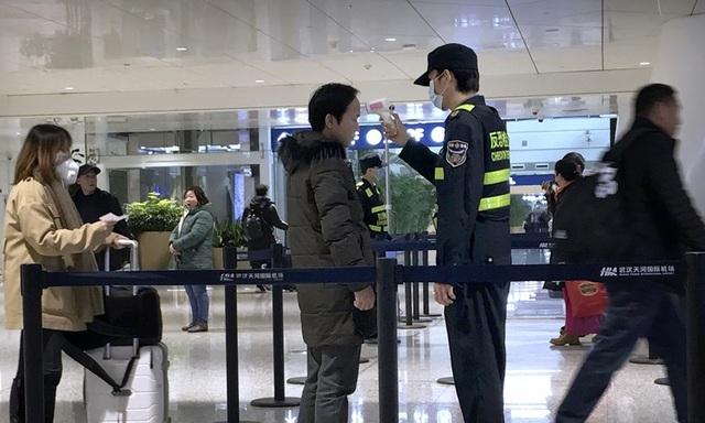 Lưu ý khẩn cấp của các sân bay trên thế giới để đối phó với virus Vũ Hán, hành khách đi máy bay trong thời gian này cần phải nắm vững - Ảnh 1.