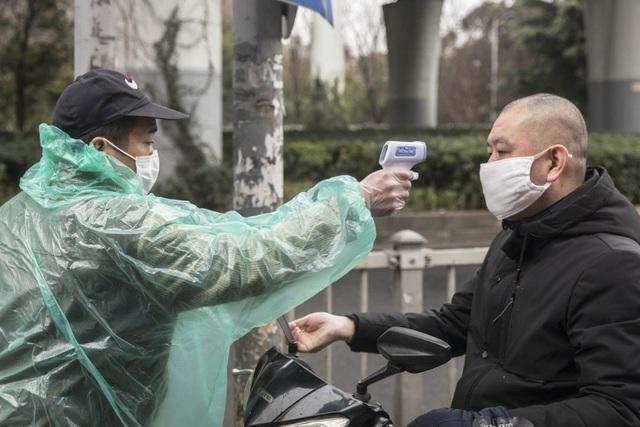Cập nhật tình hình dịch COVID-19 tại Trung Quốc và cảnh báo nguy cơ từ các bệnh nhân đã hồi phục - Ảnh 1.