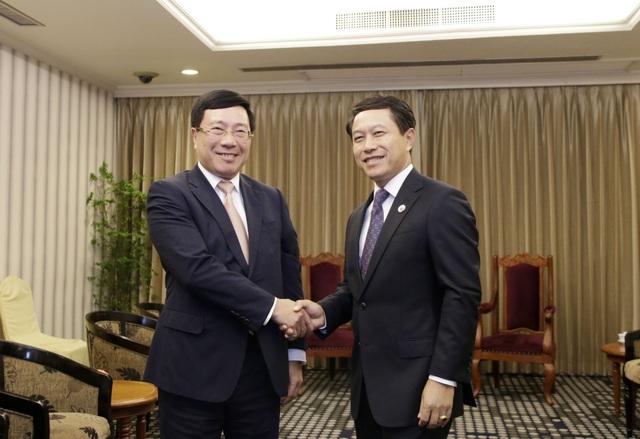 Phó Thủ tướng Phạm Bình Minh gặp Bộ trưởng Ngoại giao Trung Quốc, Lào - Ảnh 3.