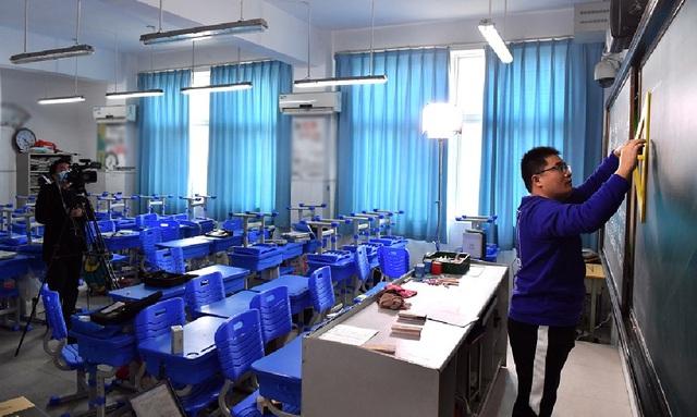 Giữa tâm dịch nCoV, Bộ Giáo dục Trung Quốc yêu cầu các trường đại học phải dạy học trực tuyến  - Ảnh 1.