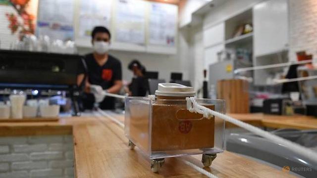 Độc đáo cách café Thái buôn bán mùa dịch Covid-19 - Ảnh 1.