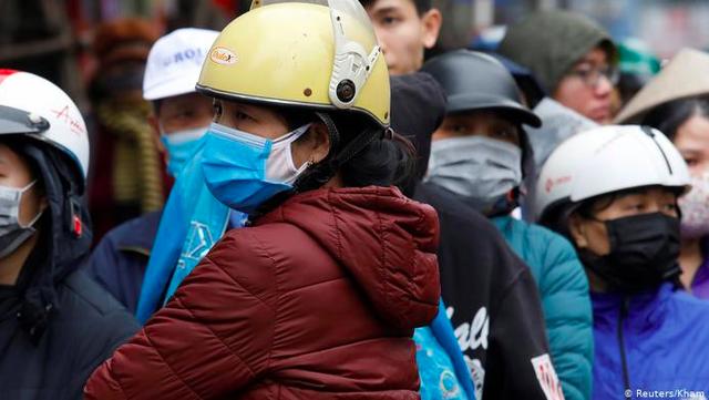Báo quốc tế ca ngợi loạt lý do khiến tỷ lệ nhiễm COVID-19 ở Việt Nam ở mức thấp so với thế giới - Ảnh 1.