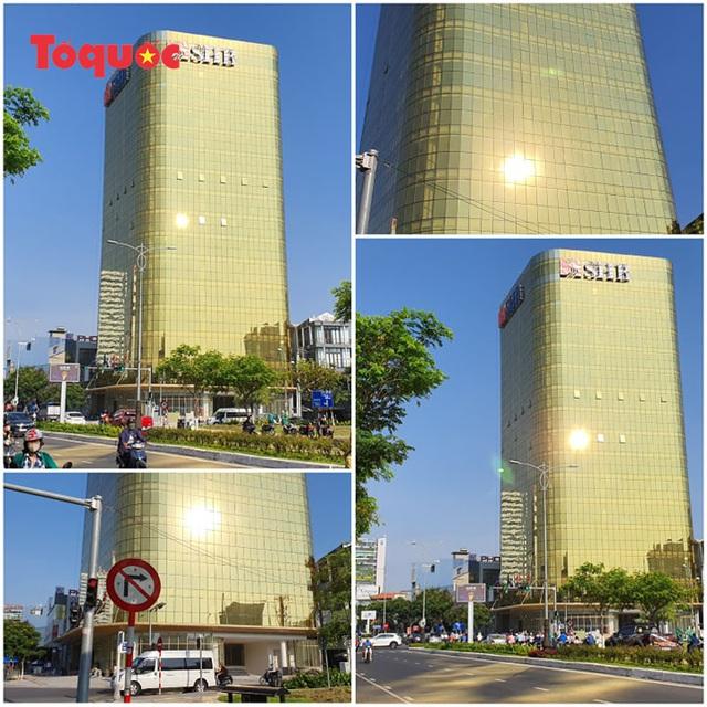 Chủ tịch Đà Nẵng yêu cầu xử lý sai phạm tại hai tòa nhà ốp kính vàng phản quang gây chói mắt - Ảnh 1.