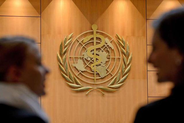 """Giằng co đổ lỗi COVID-19 đẩy họp Hội đồng Y tế Thế giới vào thế """"nín thở"""" - Ảnh 1."""