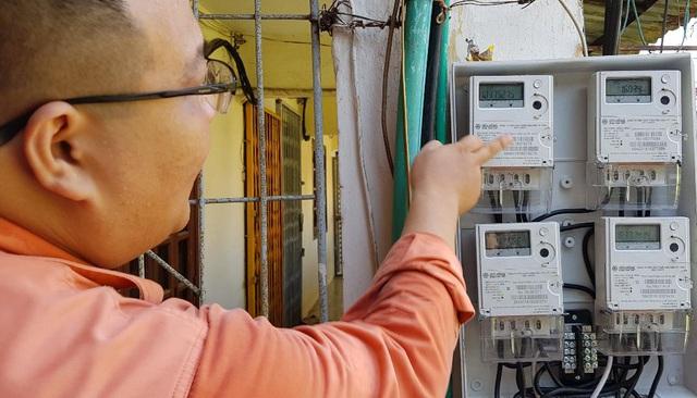 Đình chỉ công tác Phó giám đốc Công ty Điện lực Quảng Bình và Giám đốc Điện lực Đồng Hới - Ảnh 1.