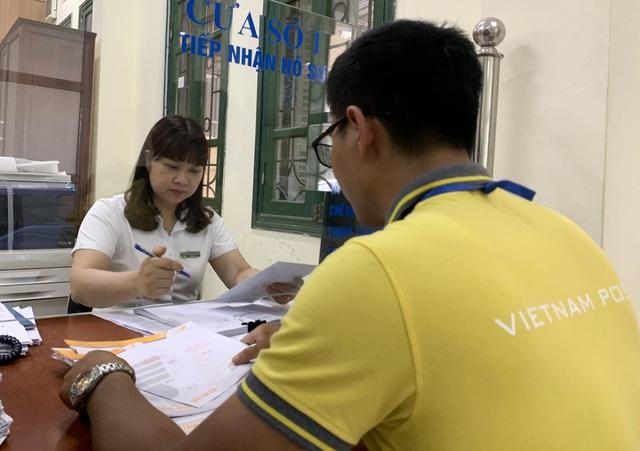 Gần 8 triệu hồ sơ hành chính được tiếp nhận và trả qua Bưu điện - Ảnh 2.
