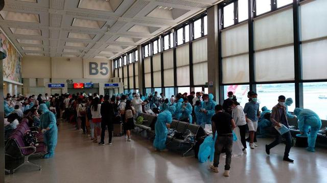 Đưa 230 công dân Việt Nam từ Đài Loan (Trung Quốc) về nước - Ảnh 1.