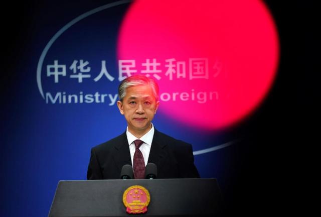 Trung Quốc tuyên bố đáp trả nếu Mỹ hành động với phóng viên - Ảnh 1.