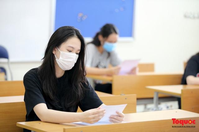 Kiểm tra y tế nghiêm ngặt cho thí sinh vào làm thủ tục thi THPT 2020 - Ảnh 15.