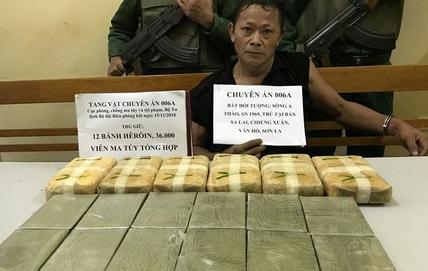 Vận chuyển trái phép 12 bánh heroin và 36.000 viên ma túy tổng hợp - Ảnh 1.