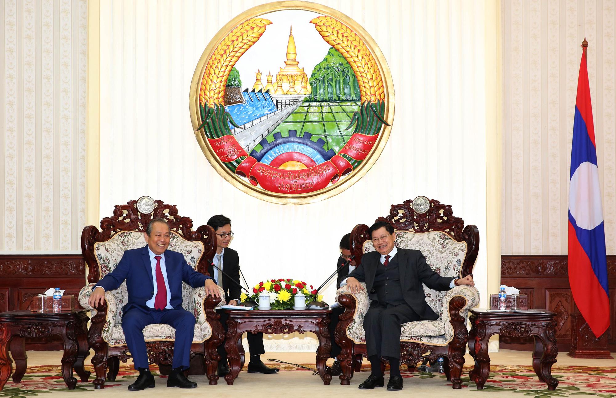 Phó Thủ tướng Trương Hòa Bình hội kiến Tổng Bí thư, Chủ tịch nước và Thủ tướng Lào - Ảnh 3.
