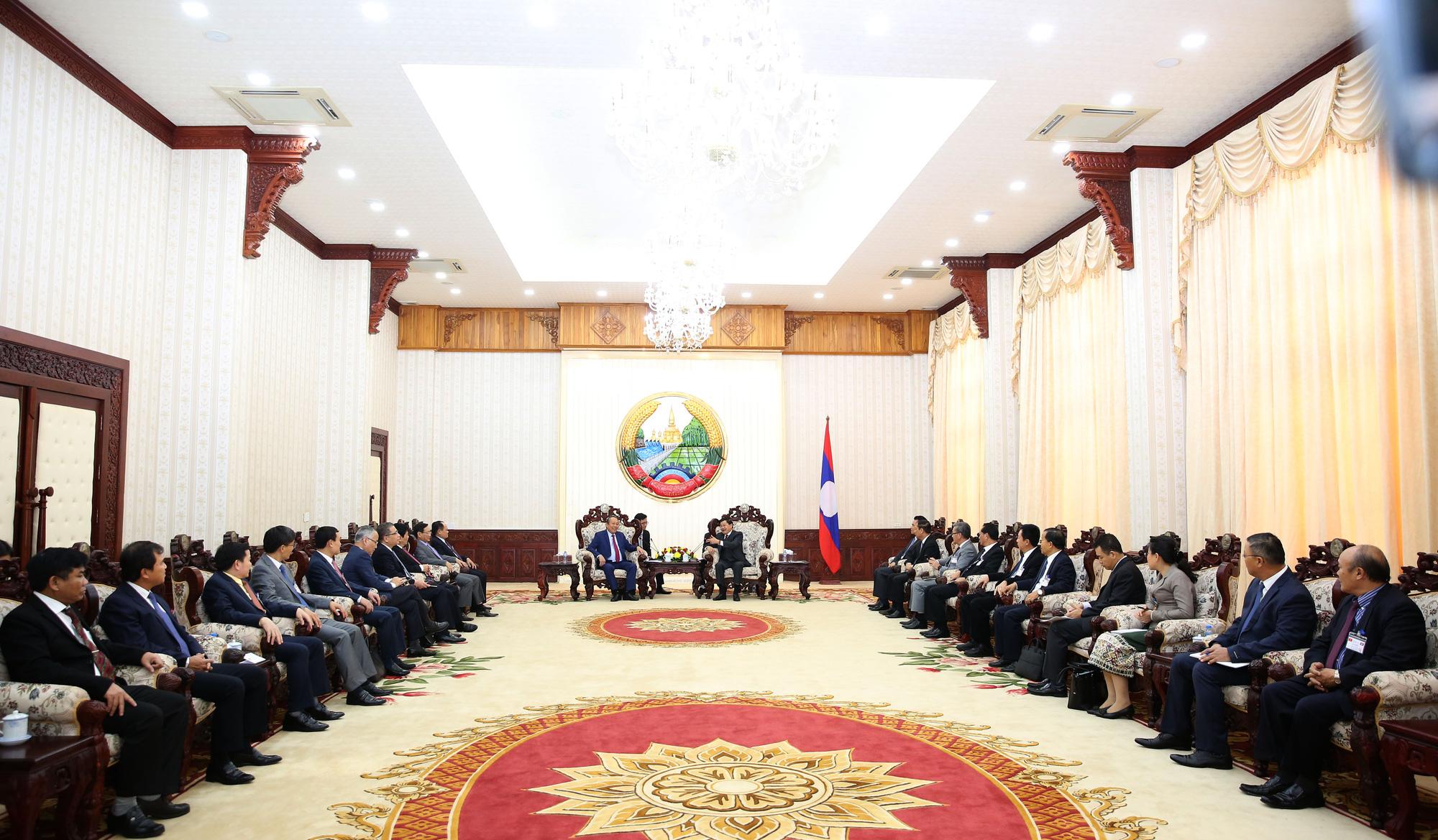 Phó Thủ tướng Trương Hòa Bình hội kiến Tổng Bí thư, Chủ tịch nước và Thủ tướng Lào - Ảnh 5.