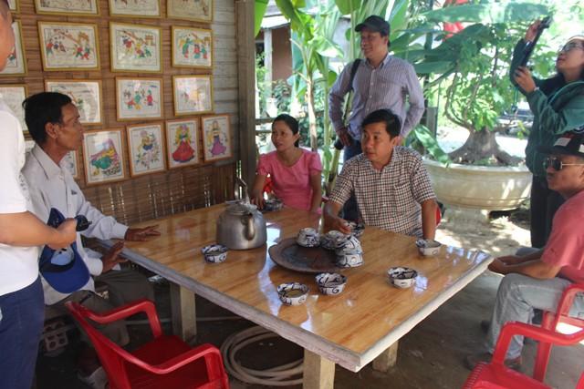 Công nhận điểm du lịch Làng nghề truyền thống Hoa giấy Thanh Tiên - Tranh dân gian làng Sình - Ảnh 1.