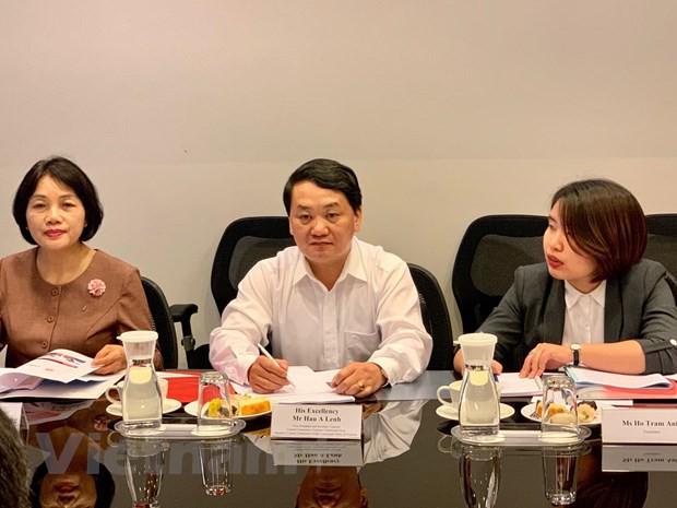 Việt Nam-Singapore đẩy mạnh hợp tác giao lưu nhân dân, văn hóa - Ảnh 2.