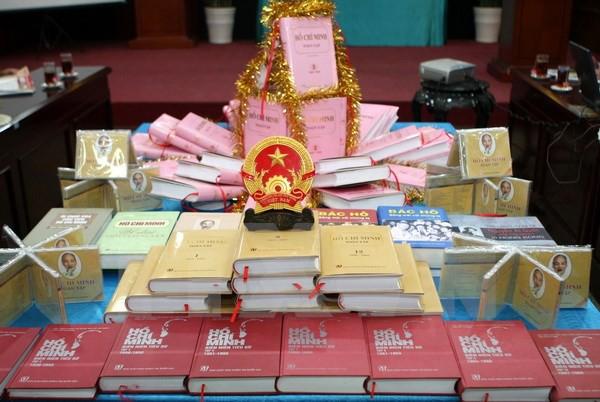 Ký kết hợp tác trong công tác xuất bản giữa Việt Nam – Lào - Ảnh 1.