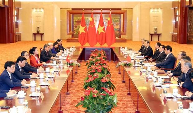 Chủ tịch Quốc hội Việt Nam hội đàm với Chủ tịch Nhân đại Trung Quốc - Ảnh 2.