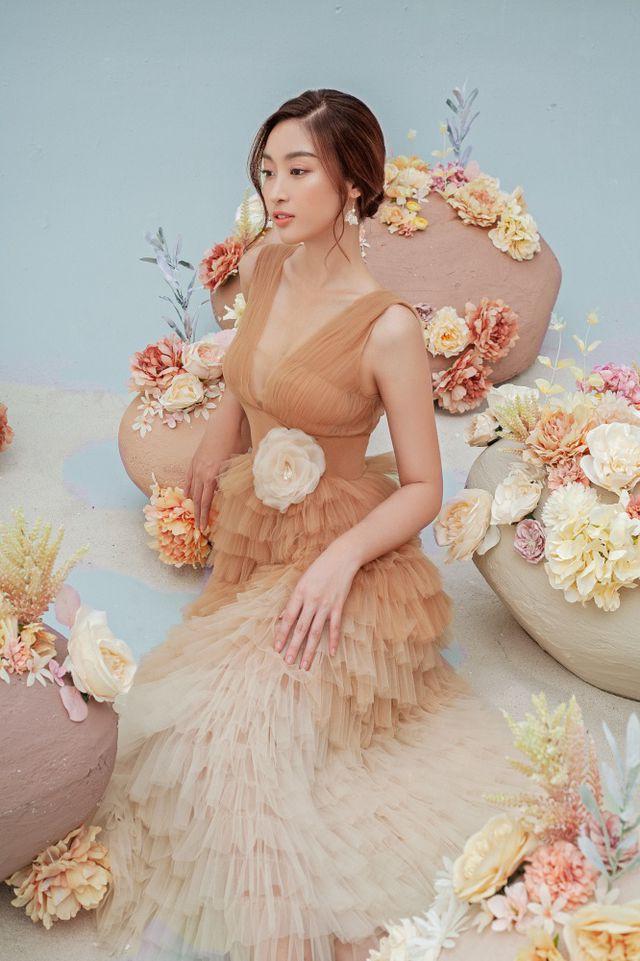 Hoa hậu Đỗ Mỹ Linh gợi cảm hơn sau tin đồn yêu thiếu gia - Ảnh 18.