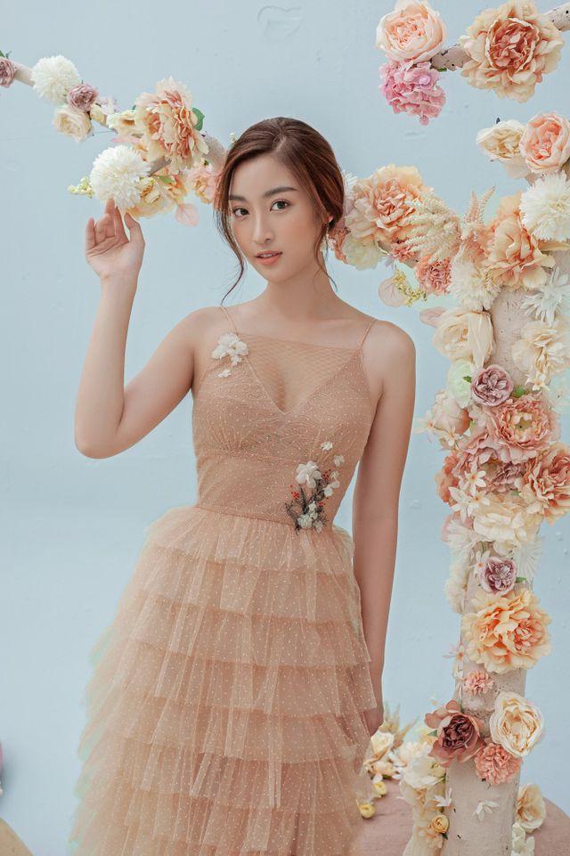 Hoa hậu Đỗ Mỹ Linh gợi cảm hơn sau tin đồn yêu thiếu gia - Ảnh 6.