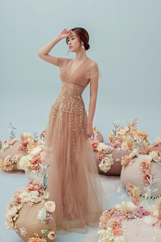 Hoa hậu Đỗ Mỹ Linh gợi cảm hơn sau tin đồn yêu thiếu gia - Ảnh 7.