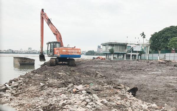 Vì sao Hà Nội tạm dừng thực hiện dự án nạo vét bùn Hồ Tây? - Ảnh 1.