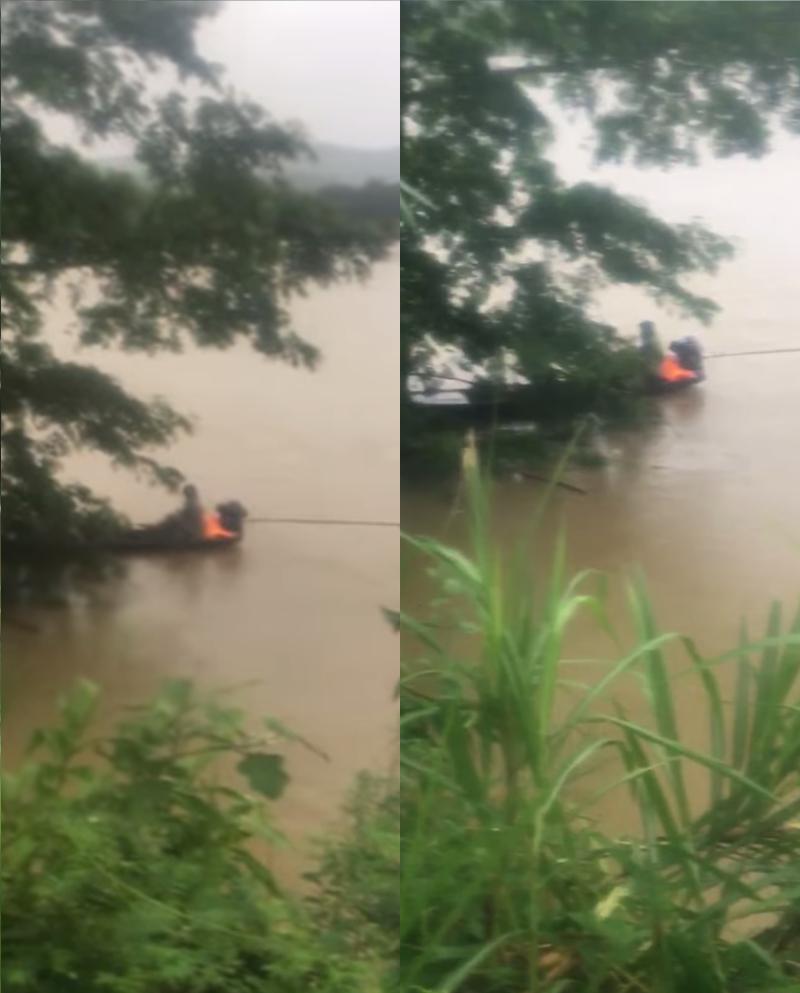 Lật thuyền trong đêm mưa, 3 người đàn ông bị rơi xuống sông - Ảnh 1.