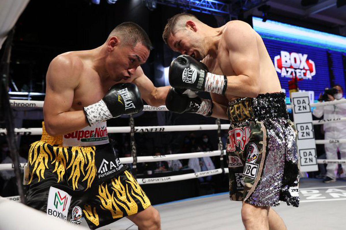 Estrada vượt khó hạ gục Cuadras, nghẹt thở bảo vệ thành công đai vô địch thế giới - Ảnh 1.