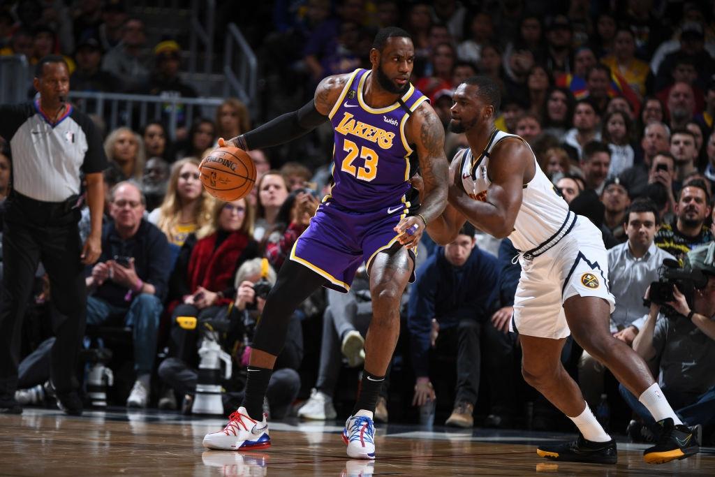 Tỏa sáng trong hiệp phụ, LeBron James và Anthony Davis đem về chiến thắng nghẹt thở cho Los Angeles Lakers trước Denver Nuggets - Ảnh 2.
