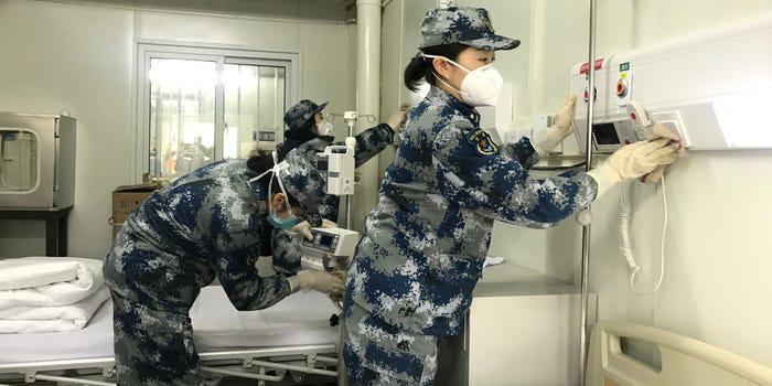 Báo chí phương Tây nghi ngờ hiệu suất thực sự của 2 bệnh viện dã chiến chống corona ở Trung Quốc - Ảnh 4.